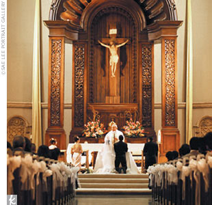 "Melanie and Hernani included several Filipino wedding traditions in their Catholic ceremony. Says Melanie, ""Our wedding party was so large [there were 23 attendants!], Father Gallagher joked that he had never seen a longer procession."""