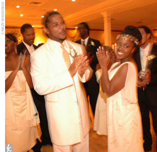 "Upon entering the reception hall, guests were treated to a special guest DJ, the legendary Kool Herc, aka ""The Father of Hip Hop."" Rachelle and her father shared an emotional dance to ""Dance With My Father"" by Luther Vandross. Stan and his mom danced to ""The Most Beautiful Girl"" by Prince."