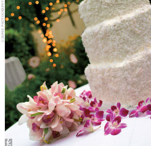 Josephine and Chris cut a three-tier, square vanilla cake filled with homemade lemon and key lime curd. The white buttercream frosting was coated with three kinds of shaved coconut.