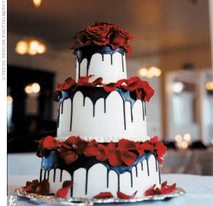 Mary and Pat&#39;s three-tier cake was drizzled with chocolate ganache, then decorated with roses and rose petals.