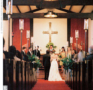 """For the ceremony, the couple (who met at a wedding) exchanged traditional Lutheran vows. """"I love the idea that we were saying the same words that thousands have said throughout time to seal their marriage covenants,"""" Kyle says."""
