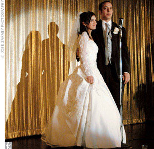 Jessica wore a satin ivory ball gown by Alfred Angelo embellished with metallic embroidery and crystal beading. For the ceremony she also sported a sheer bolero with matching embroidery and crystal detail.