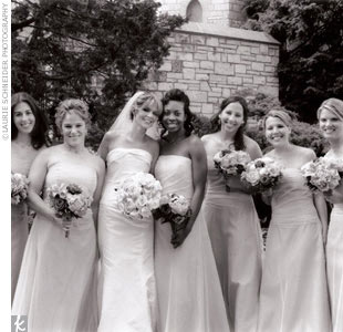 Tammy's attendants wore lilac floor-length strapless Vera Wang gowns from Amy Jane Bridal.