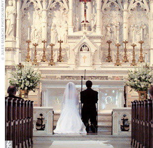 Classic arrangements of white blooms stood at the altar of the Saint Paul Cathedral as Tony waited for his bride.