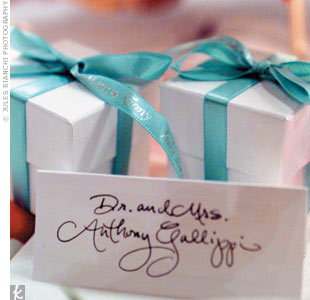 Each Tiffany Box candle, which resembled a blue box with a white bow, was placed in a white box with aqua ribbons that included Tiffani and Tony's names and their wedding date.