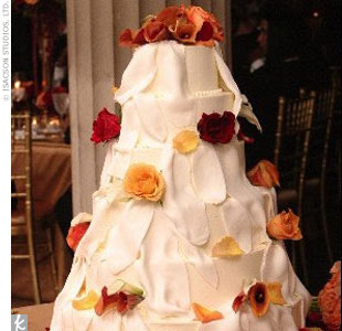 Grand Marnier, Yohannes' favorite liquor, flowed freely throughout the night. The orange-flavored spirit even made its way to the dessert table, flavoring the six-tier white fondant wedding cake.