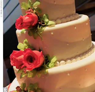 Aristea and Enzo's vanilla cake with fresh raspberries was decorated with the flower of the day -- roses.