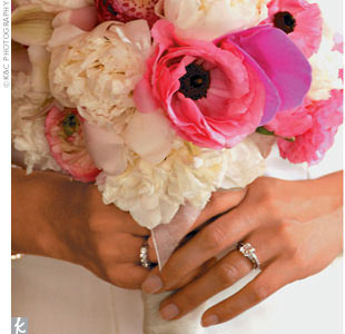 "Diemmai's bouquet included rununculus, peonies, and anemone in shades of soft pink and white. ""I loved my bouquet!"" Diemmai says. ""The flowers were gorgeous and they lasted all day."""