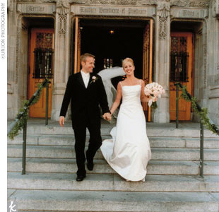 "Tiffany wore a silk duchesse satin A-line from Wearkstatt, a German designer. ""Not my intention...just a coincidence."" Her veil was long, extending slightly past the extended train on her gown. ""I added buttons down the back of the dress."""