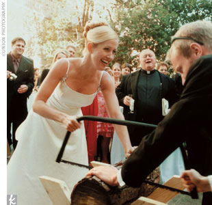 "But perhaps the most memorable moment came when Marc's dad asked the couple to perform a traditional German wedding ritual -- cutting a log in half together with a saw. Tiffany explains the reason: ""If we could do this, we could get through anything!"""