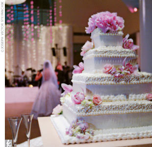 """Sandy Chang bakes the most moist vanilla buttercream cake I have ever tasted,"" Nicole raves. ""She created a simple, stacked box-style cake, and made the boxes have 'lids' which she decorated in a contemporary pattern suggestive of lace."""