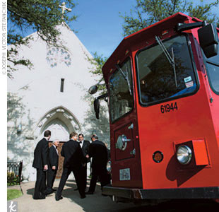 Guests rode on quaint, red trolleys to the reception.