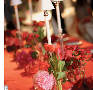 Red and pink predominated in the dramatic floral designs -- from the low, candlelit arrangements to the towering mirrored columns with willow branches rising from the tops, red and pink roses dangling from each branch.