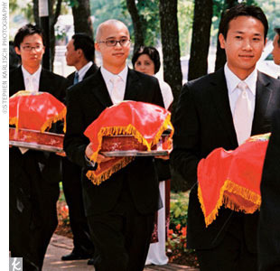 In the morning on their wedding day, Jeannine and Thien held a traditional Chinese tea ceremony at her parents' home. Jeannine wore an ao dai, or traditional Vietnamese dress, designed by the mother of the groom. Close friends and family came bearing gifts, and the couple served tea as a sign of respect for their parents and elders. Each guest then ...