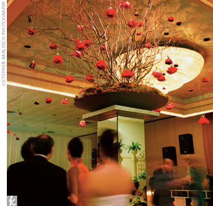 "Lavish decorations ""carefully chosen to reflect an Asian-American theme"" filled the reception space at Empress Palace. Tables were named with Chinese characters and the English translations, such as ""happiness"" and ""love."" ""Thien and I initially wanted to have our reception in a more formal setting, but we couldn't find a location to accommodate ou ..."