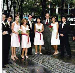 Each of Sandy's four bridesmaids wore a peony colored A-line dress with a V-neck and a fuchsia sash at the waist by Aria Bridesmaids. The guys wore dark brown suits.