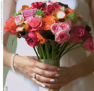 Rosie's bouquet burst with a mix of roses and calla lilies -- the groom's favorite.