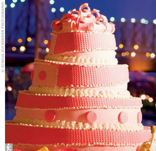 Rosie's Uncle Nino, a baker, indulged guests with 1,000 cannolis, while a family-favorite bakery crafted the wedding cake covered in a pink and white circle-and-stripe pattern.