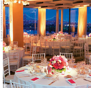 "Postceremony, the 160 guests walked to the famed UN headquarters like a scene from a New York parade -- festive and full of anticipation. The intricately lit reception space, filled with circular and square centerpieces of vibrant orange and pink flowers, boasted views of the East River. ""It was so vibrant, so New York,"" says Rosie."