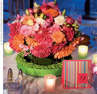 "Though the style maven had a clear vision (pink) for the event at the United Nations, Rosie says, ""once I started working at The Knot, I realized everyone else loved pink too."" So she added orange and pumped up the shade to a hot pink -- a perfect combo for the bold, Brooklyn-born bride."