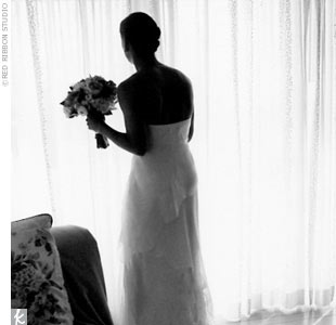 Jen chose a white sheath gown made of silk chiffon angled tiers with a small train by Amy Michelson. Her veil had a similar angled design and complemented the gown perfectly. She accessorized with a pair of diamond earrings that were a wedding gift from a close friend of Mike's family in addition and her mother in law's diamond and sapphire bracele ...