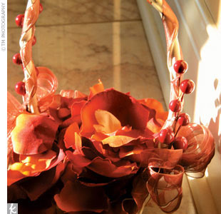 Leonidas roses and hypericum berries could be found in everything from the bouquets to the boutonnieres.