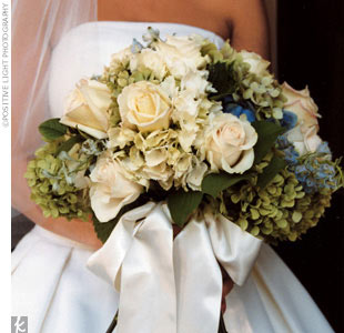 Hilary's bouquet featured white and green hydrangeas and cream roses.