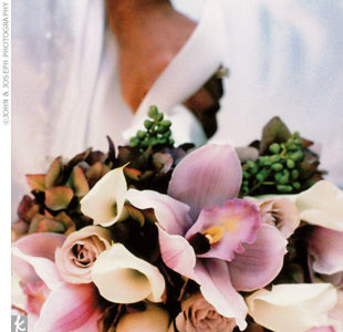 Lila carried a bouquet of lavender cymbidium orchids, white mini calla lilies, white roses, privet berries, and hydrangeas.