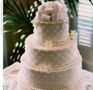 Lila and Mike cut a four-tier cake with layers of German chocolate with mocha filling and white chocolate with berry filling, iced with cream-cheese frosting.