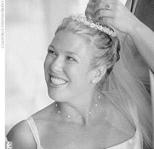 Jennifer wore a pearl-and-crystal encrusted tiara and chapel-length veil, as well as a custom-made necklace from Victoria's Bridal. Her diamond stud earrings were a surprise wedding gift from Patrick.