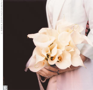 Christine walked down the aisle carrying a bouquet of calla lilies.