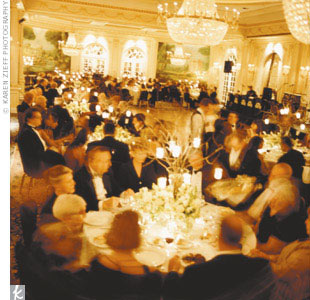 Dinner at Christine and Mark's wedding was served in the Grand Salon, with its mirrored walls and magnificent crystal chandelier. A tall vase on each table held bare branches hung with small votive candleholders.