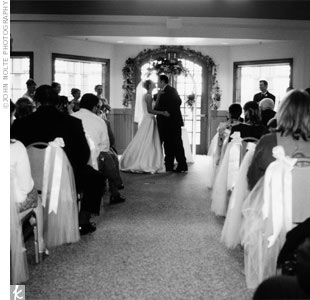 The traditional ceremony included the lighting of a unity candle. When Kristy and Alex walked up the aisle together, they were led to a private room to enjoy a glass of wine and their first moments as husband and wife alone, while their guests were treated to a wine tasting along with hors d'oeuvres.