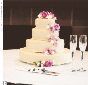 Kristy and Alex&#39;s wedding cake featured alternating layers of carrot and buttermilk cake.