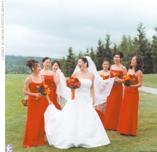 Cathy wore a gown by Mary's, while her bridesmaids' red dresses were by After Six.