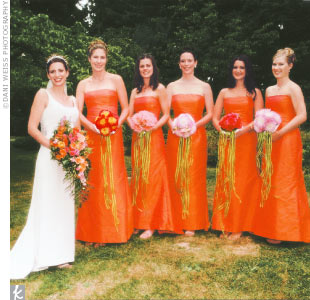 The bridesmaid dresses of raw silk shimmered from fuchsia to orange, depending on the light. The dresses were made by Tamara Fidler of Nancy's Sewing Basket. Amber's mother created her silk gown with a scoop neck, bodice trimmed with hand-stitched crystal beads, and plunging back.