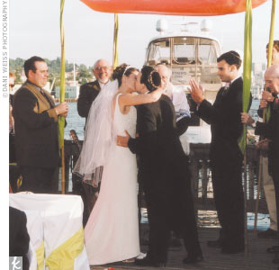 There was no question that the wedding would be held at The Lakeside, which Amber's family owns and where Amber, as a director of operations and sales, has watched countless other couples celebrate their weddings. Amber and Fernando knew guests would love the first-rate views of the Seattle skyline and the elegant, Northwest-style decor. The ceremo ...