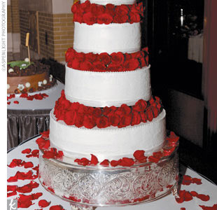 Riann and Jeff cut a magnificent five-tier wedding cake.
