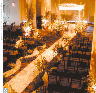 Lighting was the focus for the ceremony decor, an elegant blend of romance and fantasy. Hoping to exert a dramatic effect, the designers placed a huge emphasis on candles and soft white light to create a warm glow that would spread throughout the room.