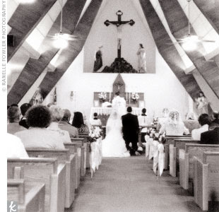 Laura and Jerome's ceremony site was the intimate Our Lady of Mt. Carmel Church, where they worship every week. Eighty guests gathered for the Latin Mass, and afterward headed for the reception.