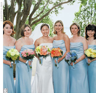 "The bride's five bridesmaids wore Watters and Watters light-blue two-piece dresses with cowl necklines. ""It's been a trend for awhile to have all different bridesmaid dresses,"" Amy says. ""Instead, I wanted to have my maids wear the same dresses, but have all different flowers."""