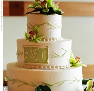 Picking up the floral motif, the golden yellow, fruit-filled cake was decorated with cymbidium orchids and personalized with the couple's monogram.