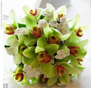 The bridal bouquet had mini green cymbidium orchids, greenery, gardenias, and stephanotis blossoms.