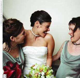 Bryn was preceded by her two bridesmaids in sage-green dresses with an iridescent wine-color shimmer.