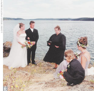"The ceremony itself was simple and brief. Says Robyn, ""We did not try to upstage the dramatic location."" Guests sat in rustic Adirondack-style chairs facing the ocean, and the bride walked to the point with her father down a winding brick path. Robyn's aunt, who is a judge, officiated."