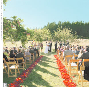 The wedding ceremony began at 5 p.m., when guests arrived to find seats among the 100 chairs, each of which held a packet of wildflower seeds from Richard's mom's garden. The minister was positioned beneath two trees heavy with red apples and balls of flowers created by the florist; a string quartet was set up beneath another tree. The highlight of ...