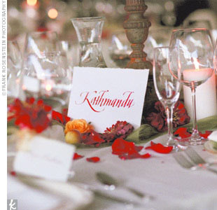 The reception was a short walk through a mown path to two tents decorated with large urns of fall-colored blooms, candle-burning chandeliers trimmed with flowers, and five long tables. Guests sampled hors d'oeuvres and then enjoyed a family-style meal.