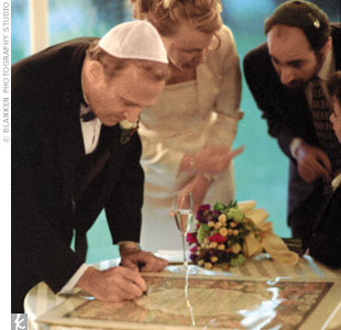 After signing the ketubah and greeting guests, the couple along with everyone else filed outside for the Jewish ceremony that began just after sundown.