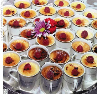A dessert buffet -- which included individual orange and vanilla creme brulee; miniature fruit tarts; milk, dark, and white chocolate truffles; and triple-dipped strawberries -- took the place of a traditional wedding cake.