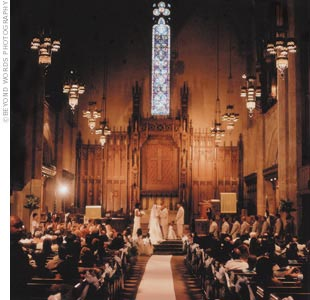 "Los Angeles' gothic-style First Congregational Church was the dramatic setting for the ceremony. The venue features powerful arched doorways and luminescent stained glass that  ""made you feel as though you were in Europe,"" according to the bride. Just minutes before the ceremony began, Aisha was informed that the minister had not arrived. Luckily,  ..."